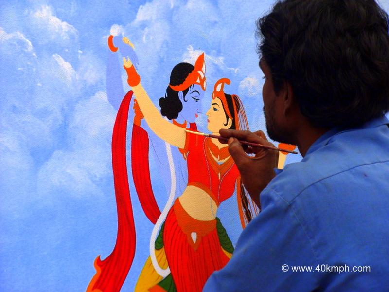 Artist Painting Picture of Radha Krishna