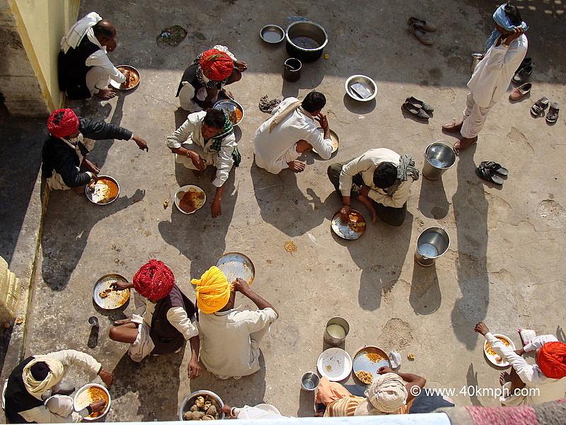 Devotees Having Prasad