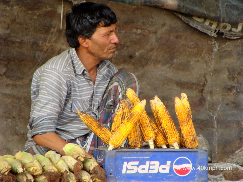 Man Selling Grilled Sweet Corn