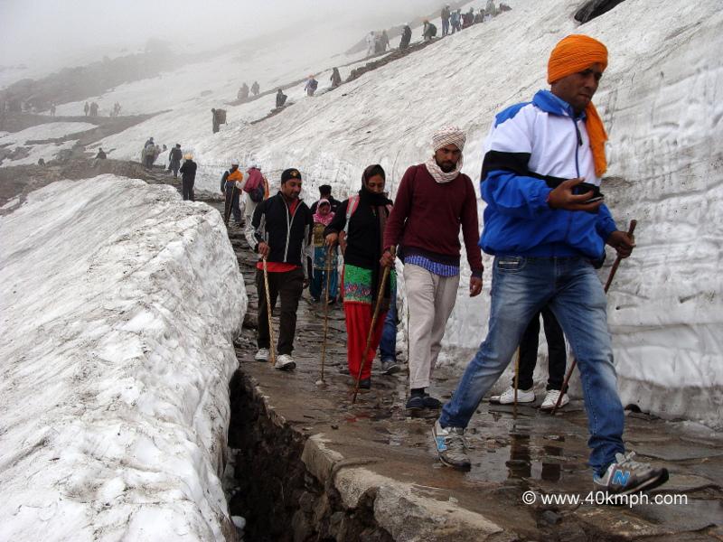 Pilgrims Trekking in Snowy Mountains, Hemkund, Uttarakhand
