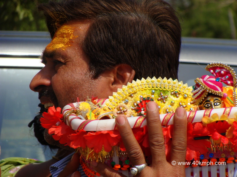 Devotee Carrying Baby Krishna during Braj Chaurasi Kos Yatra