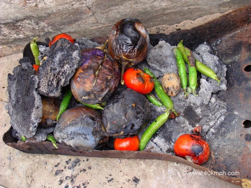 Roasting Baingan for Bharta on the Occasion of Makar Sankranti