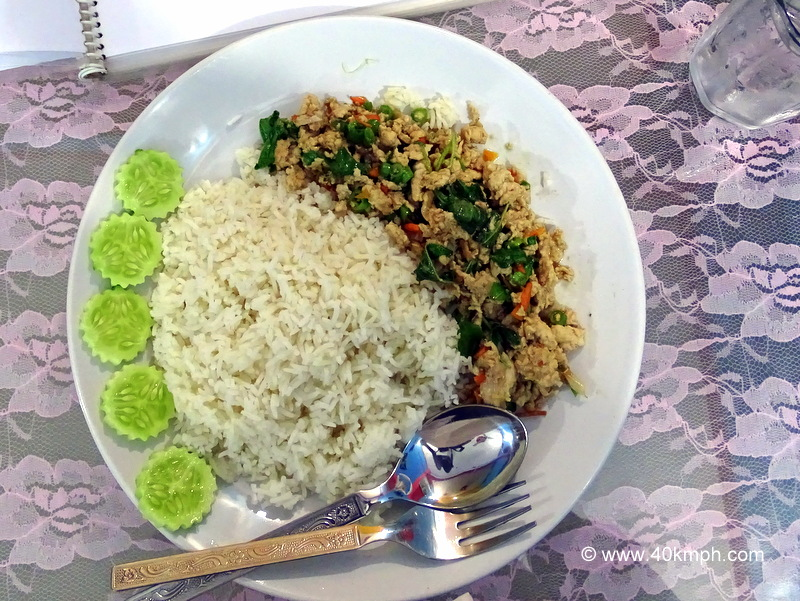 Rice Topped with Stir-Fried Chicken for Dinner