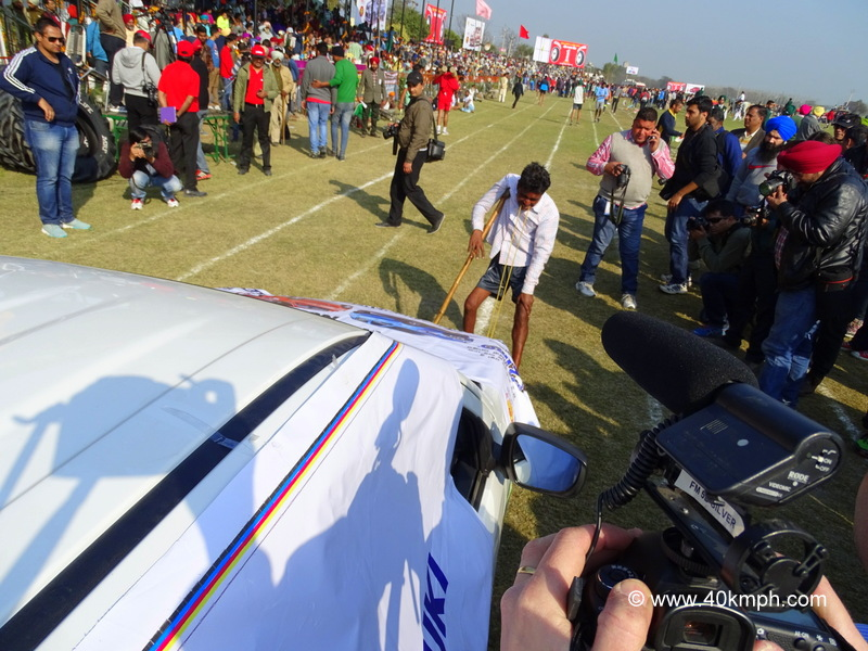 Pulling Car with Teeth at 79th Kila Raipur Sports Festival 2015 in Punjab